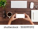 hand holding phone horizontal... | Shutterstock . vector #503099392