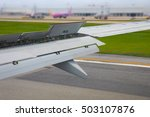 Small photo of Wing of aircraft landing.