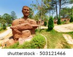 Small photo of Dalat, Vietnam - March 31, 2016: Clay sculpture of physician and bacteriologist Alexandre Yersin at the Dalat Star site in Da Lat. The Dalat Star is a popular tourist destination of Asia.