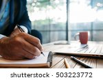 male hand taking notes on the... | Shutterstock . vector #503223772