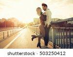 couple kissing dating on bridge ... | Shutterstock . vector #503250412
