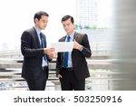 two businessmen as colleague... | Shutterstock . vector #503250916