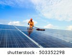 a man working on solar panels. | Shutterstock . vector #503352298