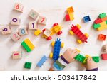 child playing with wooden cubes ... | Shutterstock . vector #503417842