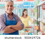 Small photo of Confident smiling supermarket clerk posing at the shopping mall, retail job concept