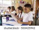 kids use tablet computers in... | Shutterstock . vector #503425942