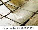 Close up Outdoor floor cleaning with high pressure water jet - stock photo