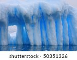 Iceberg and azure water in Antarctica - stock photo