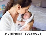 Beautiful Mother Holding...