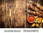 kebab with tomato sauce and...
