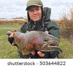 Fisherman Holding Trophy Fish ...