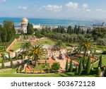 The beautiful Bahai gardens scenery with Haifa bay on the background