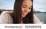 latina girl texting on...   Shutterstock . vector #503680636
