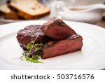 filet mignon served on a plate... | Shutterstock . vector #503716576