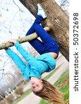 Teen Girl Hanging On The Tree...