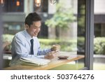 asian businessman with a cup of ... | Shutterstock . vector #503764276