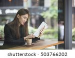 asian businesswoman with a cup...   Shutterstock . vector #503766202