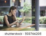 asian businesswoman with a cup...   Shutterstock . vector #503766205