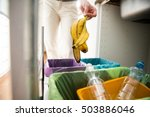 Woman Putting Banana Peel In...