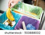 woman putting banana peel in... | Shutterstock . vector #503888032