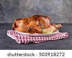 chicken roasted on red napkin.... | Shutterstock . vector #503918272