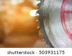 Small photo of Close up blade of circular saw on blurred background, sunshine effect