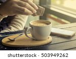 pour sugar into a cup of coffee | Shutterstock . vector #503949262