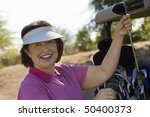 woman selecting golf club from... | Shutterstock . vector #50400373