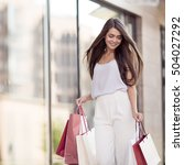 young happy woman with shopping ... | Shutterstock . vector #504027292