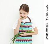 kid holding green onion