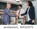 shaking on a business deal in... | Shutterstock . vector #504122572