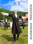 Small photo of ADYGEA, RUSSIA - JULY 25 2015: Adyghe boy in Circassian national costumes dance to the ethnic festival in the mountains of Adygea
