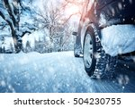 car tires on winter road... | Shutterstock . vector #504230755