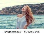 woman on the beach taking deep breath enjoying fresh air freedom