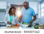 couple preparing food in kitchen | Shutterstock . vector #504307162