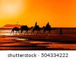 Silhouette Of Camel Caravan At...