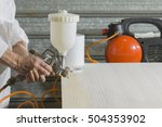 Small photo of a person decorating or painting with a airbrushed