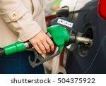 woman fills petrol into her car ... | Shutterstock . vector #504375922