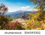 man walking on the edge of a... | Shutterstock . vector #504395302