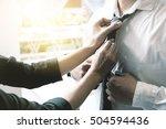wedding day a woman help tine a ... | Shutterstock . vector #504594436
