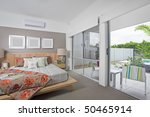 master bedroom in modern Australian townhouse - stock photo