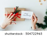 woman holding christmas gifts... | Shutterstock . vector #504722965