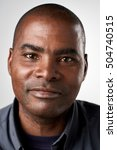 Stock photo portrait of real black african man with no expression id or passport photo full collection of 504740515