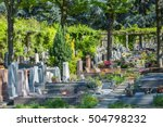 Flowers In A Cemetery With...
