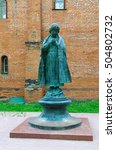 Small photo of UGLICH, RUSSIA - JULY 19, 2016: Monument to Tsarevich Dimitry near brick walls of House of Uglich feudal princes in Uglich Kremlin, Russia