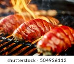 lobster tails being grilled... | Shutterstock . vector #504936112