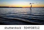 windsurfer sailing in the lake... | Shutterstock . vector #504938512