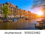 Stock photo traditional old buildings and and boats at the sunset in amsterdam netherland 505022482