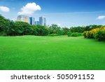 green grass field in big city... | Shutterstock . vector #505091152