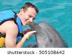dolphin kiss man in blue clean... | Shutterstock . vector #505108642